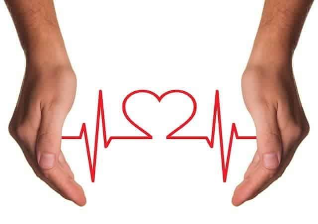 rysunek EKG pomiędzy dłońmi